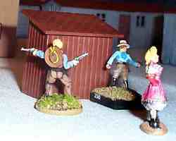 Nevada Nell skulks with her gang behind the outhouse, planning to take over the town.